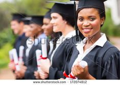 pretty african female college graduate at graduation with classmates by michaeljung, via Shutterstock