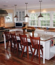Cottage Kitchen with Cherry - amberwood 5 in. engineered hardwood wide plank, Kitchen island, Pendant light, Breakfast bar