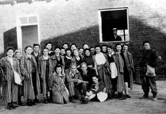 Jewish inmates who were liberated from the Janowska [sic. Pawiak] prison by soldiers of the Zoska batallion of the AK during the Warsaw Polish Uprising. Warsaw.