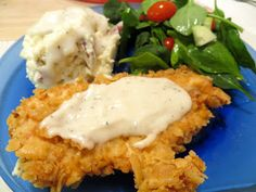 Paula Dean's chicken fried chicken, mashed potatoes, and milk gravy