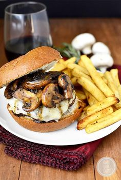 Sautée mushrooms with fresh rosemary and garlic, then reduce with beef broth and serve atop a burger patty with melted Swiss cheese.