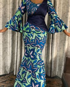 Wax skirt and blouse combined with raw silk elegantly sewn a - Grand Ateliér media photos videos Latest African Fashion Dresses, African Dresses For Women, African Print Fashion, African Print Dresses, African Attire, Ankara Gown Styles, Ankara Gowns, Ankara Skirt, African Fashion Traditional