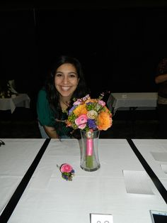 Aranza's brightly colored bouquet with broaches.