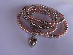 Pulseira 4 fios - rosa e prateada com pingente de coração