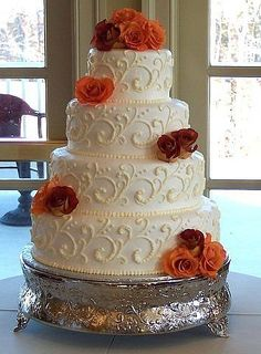 I love this basic wedding cake.  Simply add the color of flowers that blend with your wedding.