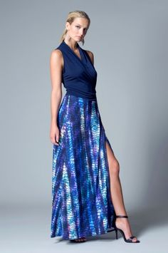 Alta Dress from Julian Chang. Draped, sleeveless, v-neck dress featuring contrast skirt. Tie at side. $160
