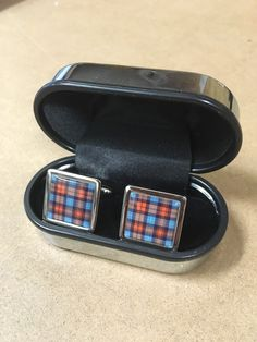 Steel cufflinks with resin dome inset featuring MacLachlan ancient tartan design