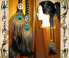 Braided Hair Extensions with Siver Conches above Peacock Feather