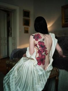 Photorealistic Hibiscus Back Tattoo by Björn Abelin photography