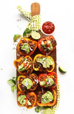 HEALTHY Spanish Quinoa Stuffed Peppers! 10 ingredients, packed with protein and fiber, and SO flavorful! #vegan #glutenfree #recipe #healthy #dinner #minimalistbaker