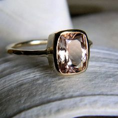 yellow gold with pink stone. I just love the rose gold look!