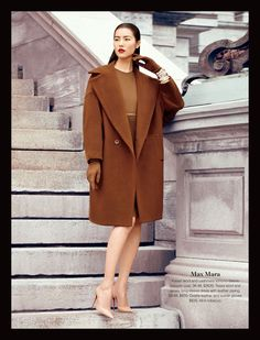 Max Mara- Kaiser wool and cashmere kimono-sleeve cocoon coat. 36-48, $2630. Tessa wool and jersey long-sleeve dress with leather piping. 38-48, $830. Ovatte leather and suede gloves. $635. All in tobacco. #holtsmag