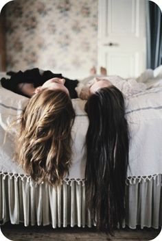 hair hanging over the bed