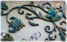 Chipboard coloring technique -  used some embossing powders on it in gold and blue, then added a bit of green mica powder (Pearlex) and then added some Glossy Accents to coat it all.