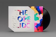Album art by Post Projects for artists The Hope Slide, with die-cut slip cover forming band name out of colour on the record sleeve.