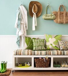 A skinny bookcase flipped on its side is augmented with wheels to make a mobile piece of furniture for the front entry. Outfitted with a cushion and pillows, it introduces an inviting spot to slip on shoes and stash pet supplies. Pair the bench with a few decorative hooks to hang jackets and bags. Vary the level of the hooks to accommodate younger and shorter members of the family.
