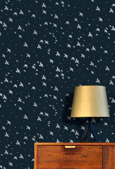 The second wallpaper from our new Saturday Night/Sunday Morning collection. A murmuration of starlings swoop among star constellations, picked out in silver on a midnight sky.Available soon...