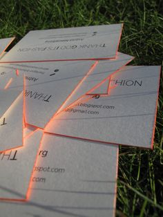 Cool way to add some interest to your business cards with neon spray paint.