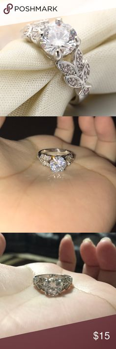 Sterling Silver 925 Cubic zirconia ring pretty This is a very pretty sterling Silver ring with leaves on the side very pretty and elegant,   Size: 6,9   Please don't hesitate to ask me any questions Jewelry Rings