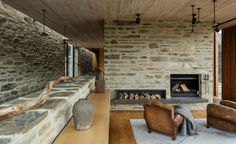 RTA Studio designs a sustainable mountain lodge at one with its scenic setting in New Zealand. Inglenook fireplaces, comfortable furnishings and a mix of warmer and cooler colour schemes underscore the welcoming atmosphere of this family home