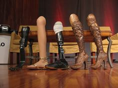 Aimee Mullins Wooden Legs: McQueen replace her prosthetic with a pair of intricately carved wooden boots, McQueen made something ugly into something beautiful.