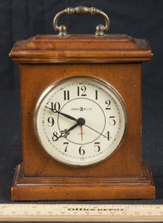 HOWARD MILLER DESK TOP CLOCK WITH WOOD CASE AND BRASS HARDWARE.