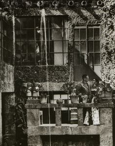 Frida with her 'Panzón' in her yard. Mexican artists Frida Kahlo (1907-1954) & Diego Riviera (1886-1957) overlooking the garden at La Casa Azul, Coyoacan, Mexico City.