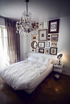 love the white bedspread and frames