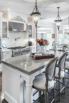Light Kitchen with Clareanne Cambria Quartz Countertop Kitchen Island with White Cabinets, Stainless Steel, and Bar Stools. Kitchen Redo, Home Decor Kitchen, New Kitchen, Home Kitchens, Kitchen Remodel, Kitchen Makeovers, White Kitchen Decor, Decorating Kitchen, Dream Kitchens