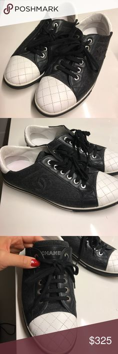 CHANEL Grey Fabric & White Leather CC Sneakers Stay on-trend this season with these Chanel sneakers! Featuring a speckled dark grey fabric, subtle CC logos on the sides, and detailed with quilted white leather. Perfect for a quick jaunt around the block or even everyday wear, these are very chic city sneakers. The soles have light wear. The uppers are clean and beautiful with slight scuffing to the white leather. The footbeds have minor stains, but otherwise the shoes are in excellent…
