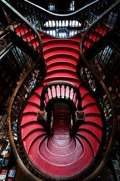 The view inside a Portuguese book shop.  Probably wouldn't have painted the stairs red. . .
