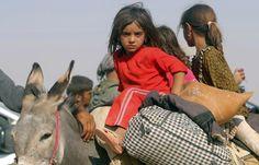 Yazidi Kurds Flee Iraqi Violence