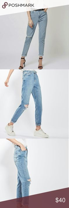 Topshop Mom Jeans Crafted from cotton, this MOTO Mom jeans come in authentic rigid-look denim. Cut with a high-waist and a tapered leg, they feature multiple pockets, classic trims and a rip to one knee. Wear them folded at the cuffs to keep them looking cool. 100% Cotton.?Great condition. Topshop Jeans