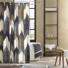 Elegant floral embroidery highlights this lovely shower curtain from Lush Decor. Constructed of faux silk, this shower curtain features a brown and blue color palette and is finished with pleated deta