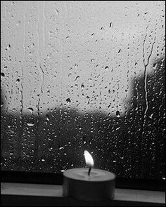 Candle in the rain