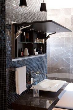 A mirrored vanity panel that opens up to hidden shelves recessed into the tiled wall ~ a very clever solution to limited storage space in a bathroom fabulous
