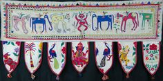 Rare vintage stylised toran , from Gujarat, hung over door as sign of welcome. approx 60years old, good condition. 105cm 50cm inc flags http://worldbasket.co.uk/product-category/antique-and-vintage-textiles/