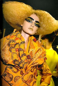 Dior Backstage by Roxanne Lowit ▪ In her book Backstage Dior, Roxanne Lowit showcases some of the most vibrant close-ups of makeup looks and fashions she photographed at Christian Dior runway shows over the years. This confection in yellow has its inspiration in Gustav Klimt's portraits.