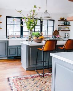 Loving these blue/gray cabinets and warm wood open shelving. ❤️ Also a some @serenaandlily sales picks up on Beckiowens.com. @jenkayphoto