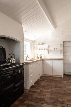 Small cottage kitchen ideas – design inspiration for rural homes | Country Small Cottage Kitchen, Cottage Kitchens, Plain English Kitchen, English Cottage Interiors, Wooden Beams Ceiling, Wall Cupboards, Flagstone Flooring, Timber Table, Kitchen Design