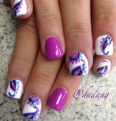 Cute Purple nail art design. You can create pretty abstract designs on your nails with the purple polish along with other complimentary colors.