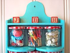 red and aqua shelf - love!  This photo and several others came from Allsorts blog...