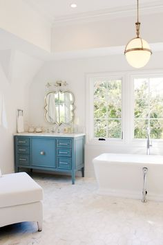 White bathroom with blue cabinet turned sink