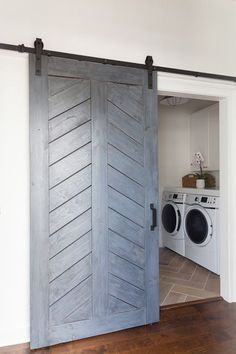 Add the farmhouse style to your home with these sliding barn door ideas! There are so many barn door styles and barn door designs to choose from so use our guide to help you decide the right barn door decor for you. Barn Door Decor, Diy Barn Door, Barn Door Hardware, Wood Barn Door, Metal Barn, Laundry Room Doors, Basement Laundry, Bathroom Doors, Barn Door Designs
