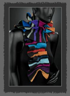 High fashion and functional, this is K. Gereau Textile's most popular piece. This scarf's ruffled edges create a collar around your neck. Made from Merino Wool & Silk blends. Knitted then felted. American Made. 2013 Buyers Market of American Craft. americanmadeshow.com