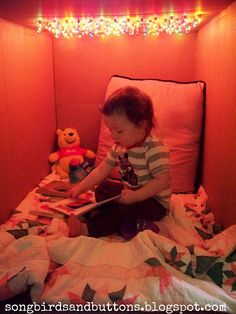 Wyatt's Light Cave. Poke holes in a cardboard box- push a string of colorful Christmas lights through the holes- AWESOME fort and reading nook for kids! (Bottle Lights For Kids)