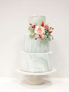 Desert theme marble fondant wedding cake