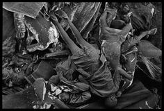 Thousands were buried anonymously in mass, communal graves in Zaire, 1994. By James Nachtwey