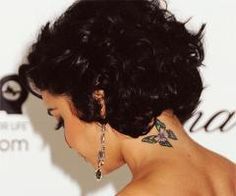 As cliche as it may be, I would actually really like a butterfly tattoo like hers. it looks good on her!