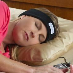 The Sleep Assisting Music Headband - Hammacher Schlemmer  Soft headband that has built-in headphones.